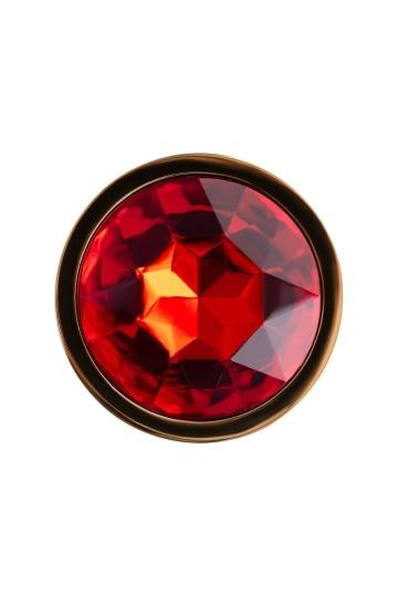 Золотистая гладкая коническая анальная пробка с красным кристаллом - 7 см.